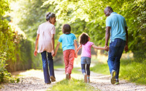 Header - Family Walking in Park
