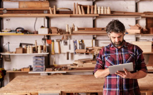 Header - Man on Ipad in Carpentry Workshop